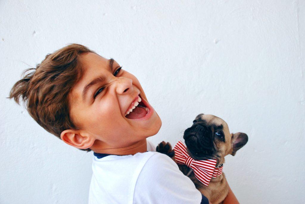 does my dog love me - happy boy hugging a dog