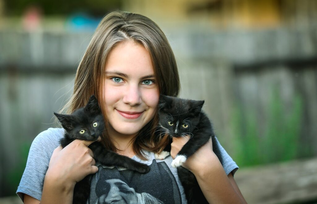 girl with two kittens