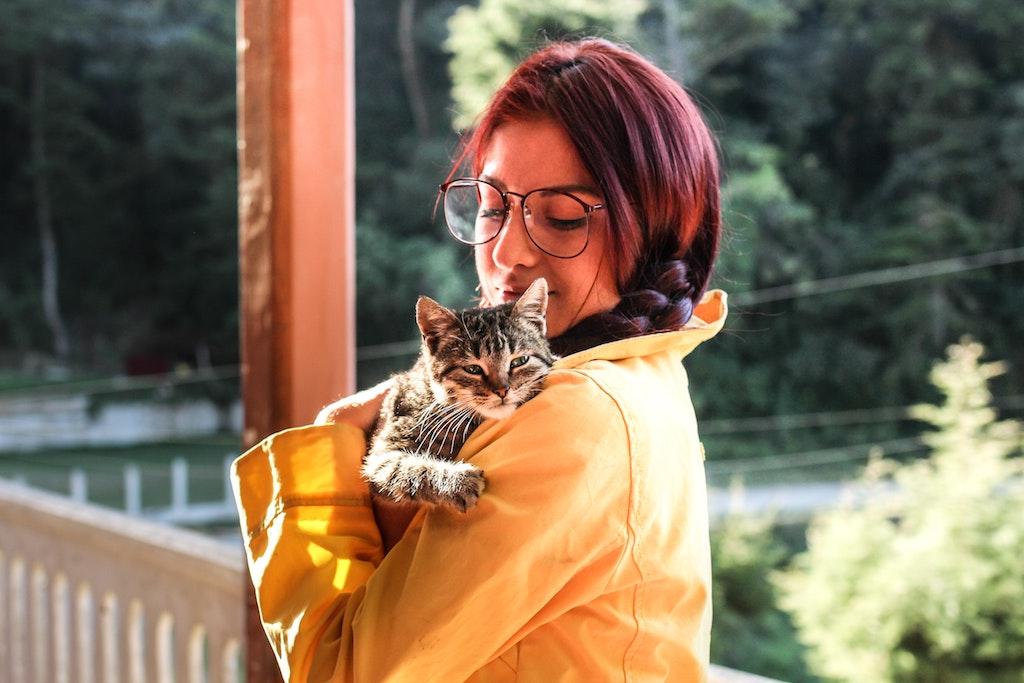 woman hugging a cat - cat diabetes